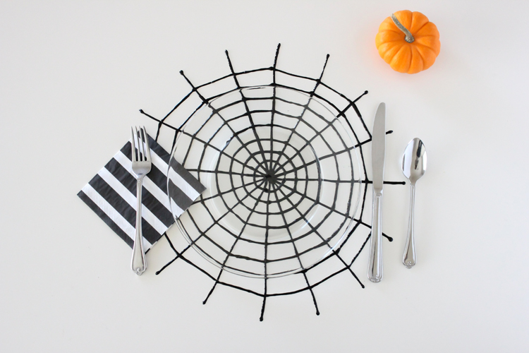 Halloween Spiderweb Place Mats - made from puff paint! // Delia Creates