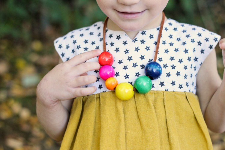 DIY Toddler Safe Necklaces. They are fun to make and have a unique safety clasp in the back! || Delia Creates