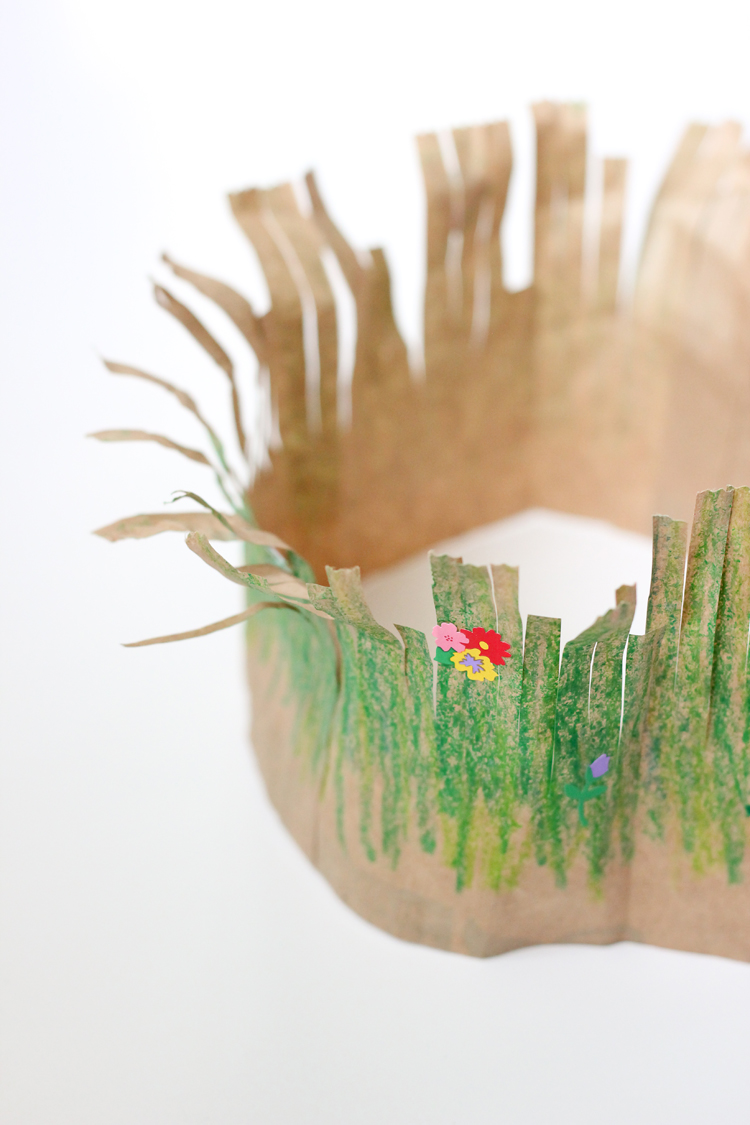 Whip up these easy, toddler friendly paper grass crowns for Earth Day! // via Delia Creates