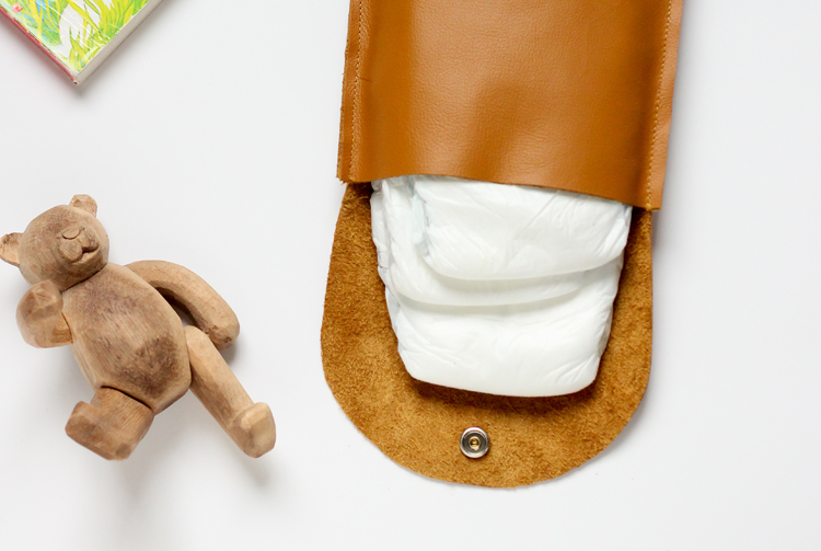 Make this simple leather diaper clutch using this really easy tutorial. // Delia Creates