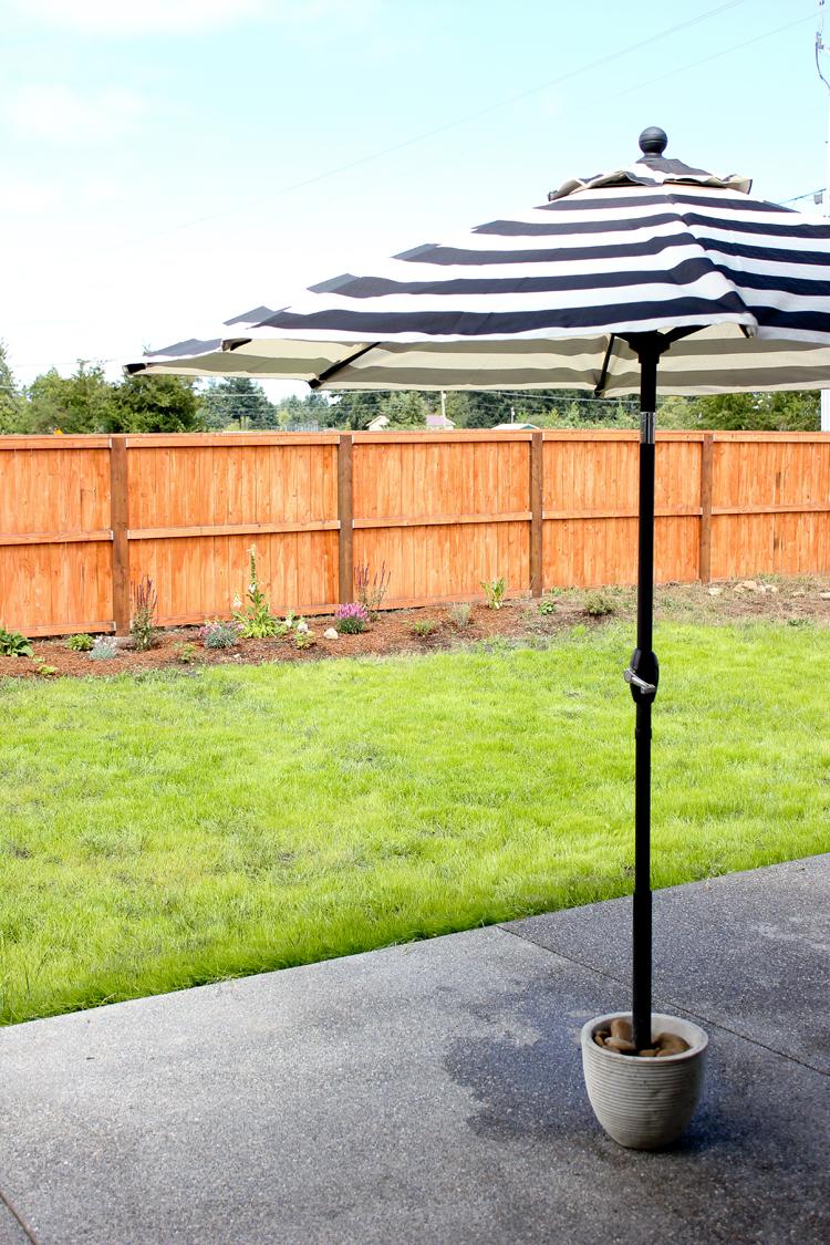 Easy DIY Patio Umbrella Stand Tutorial ( for under $20!) // www.deliacreates.com