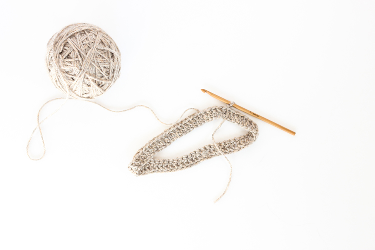 Skip Twist Cabled Beanie - FREE Crochet Pattern // www.deliacreates.com