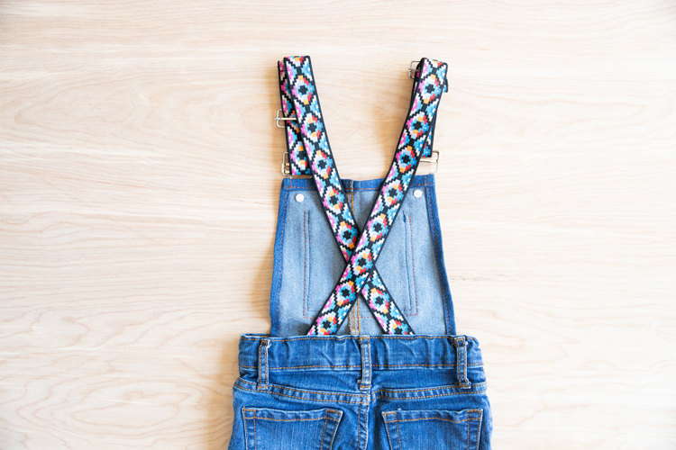 Easy Overalls Tutorial with Elastic Straps and Buckles // www.deliacreates.com // Make cute overalls from an old pair of pants! Elastic straps stay on easier.