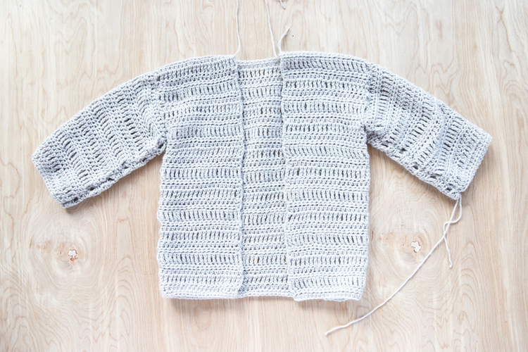 Oversized Crocheted Cardigan FREE PATTERN + Tutorial // www.deliacreates.com // Learn how to make a crocheted cardigan using just basic stitches! Perfect for cozy fall weather! #crochet #crochetsweater #crochetforfall