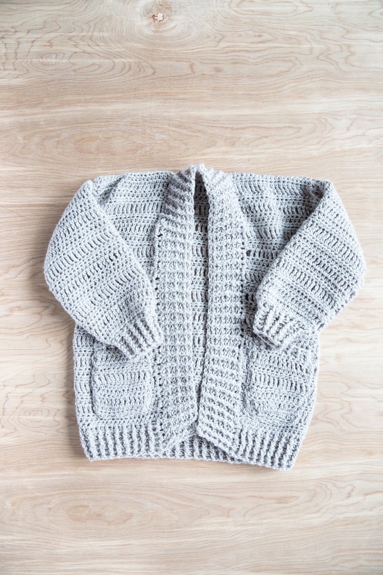 Crochet your own cardigan with this FREE PATTERN + Tutorial // www.deliacreates.com // Learn how to make a crocheted cardigan using just basic stitches! Perfect for cozy fall weather! #crochet #crochetsweater #crochetforfall