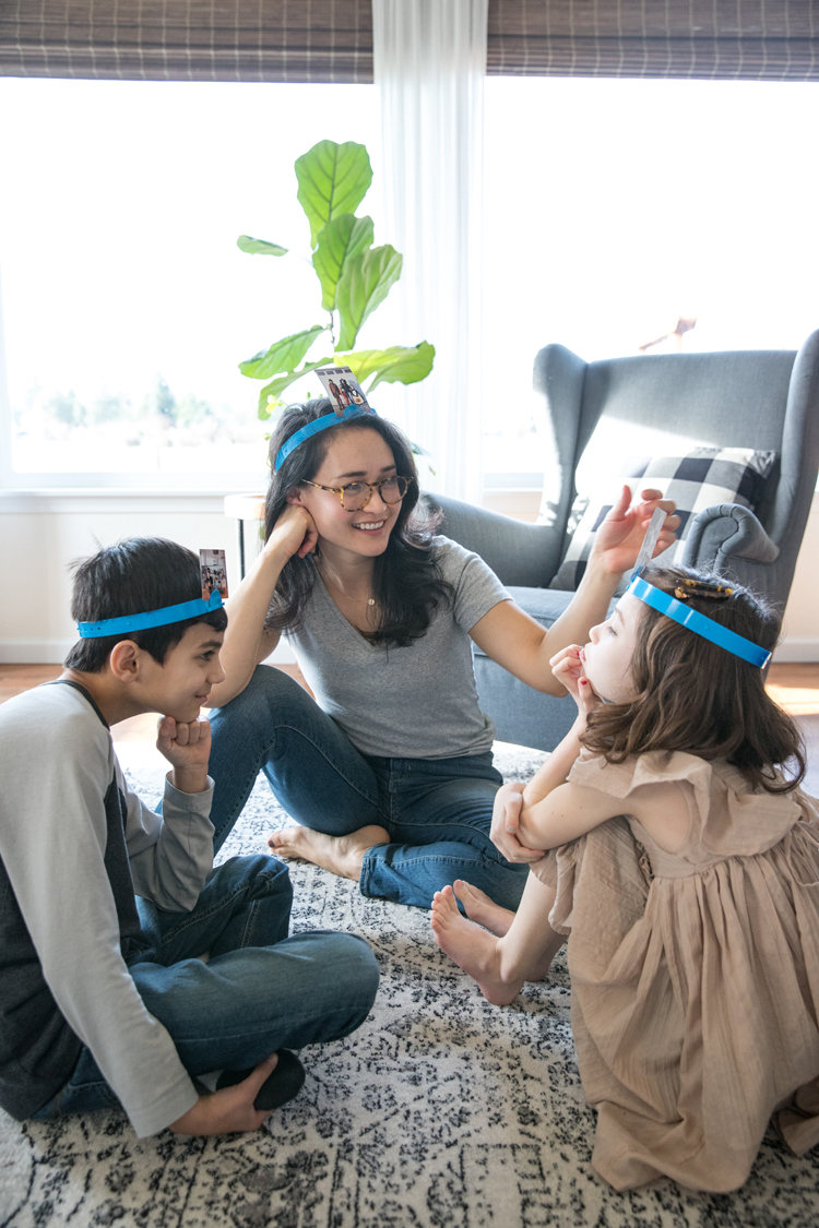 7 Easy ways to make New Year's Eve fun for kids and families! // Print photos and use them to play Headbanz! // www.deliacreates.com