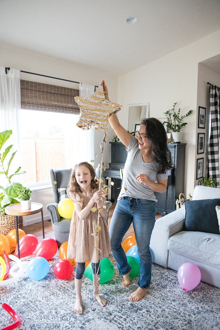7 Easy ways to make New Year's Eve fun for kids and families! // Pull a string pinata when counting down! // www.deliacreates.com