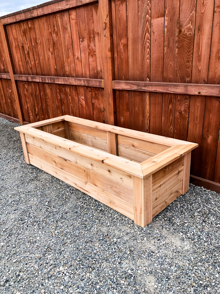 How To Make Cedar Raised Garden Beds // www.deliacreates.com// step by step tutorial with pictures, and tips on where to buy inexpensive lumber